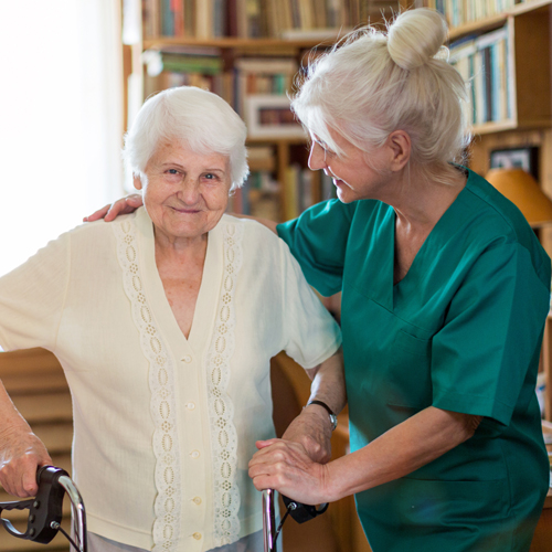 helping elderly disabled woman
